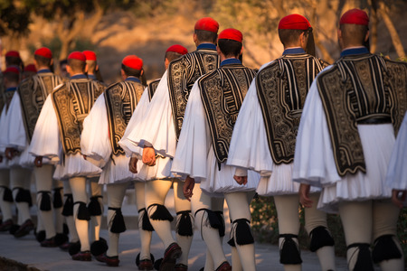 Athens, Greece - August 28, 2016: Lineup of soldiers, dressed as Evzones or Presidential Guard, marching to Acropolis of Athens, Greece. The uniform is catching everybodys eye. Editorial