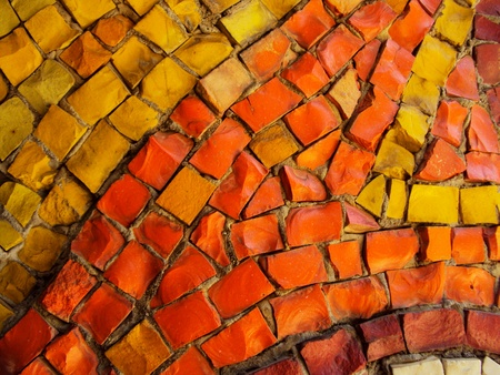 A part of mosaic - many square and rectangular pieces of different color that decorate a fountain  photo
