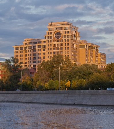 Modern apartment building on the bank of moscow river at sunset. Russia photo