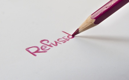 unaccepted: A pencil writes the word refused Stock Photo
