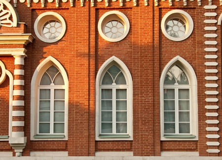 the tsaritsyno: Brick wall with windows of gothic Tsaritsyno palace