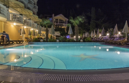 Swimming pool and the hotel at night