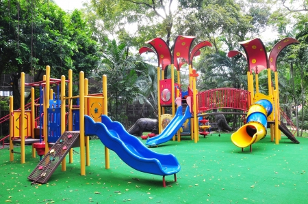 recreational area: a colourful children playground equipment. Stock Photo