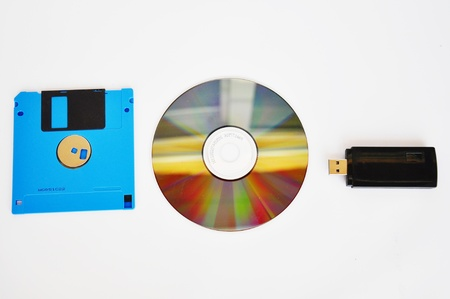 the optical and floppy disc isolated on the white background