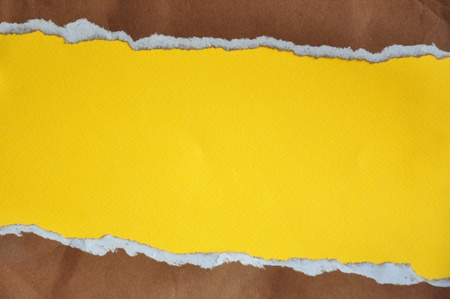 Rip brown Paper and yellow background photo