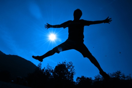 man silhouette  superb freedom jump Stock Photo