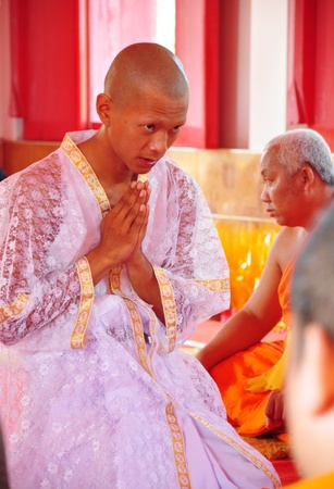 Thai man during a Buddhist ordination ceremony during which he becomes a monk