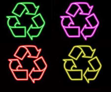 neon colorful recycling sign, green outline over black  photo
