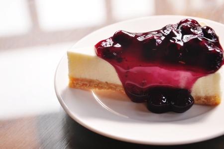ambrosia: Blueberry cheesecake on white background  Stock Photo
