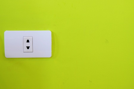 North American white electric wall outlet receptacle green Stock Photo