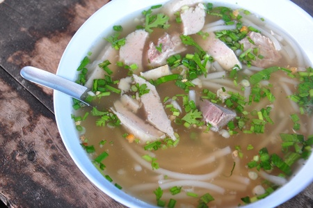 vietnamese pho soup, an ethnic meal of chicken soup, broth, bean sprouts, noodles and basil or cilantro floating on top