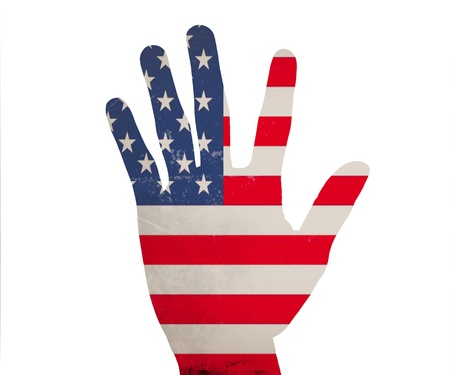 Hand in colored america national flag as symbol of excellence,