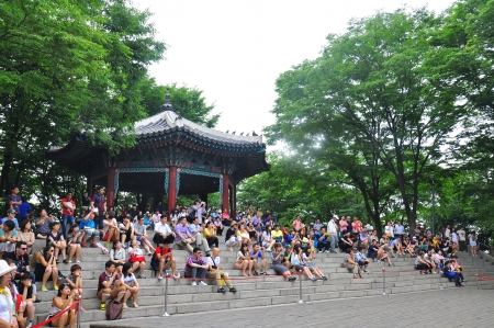 CENTRAL SEOUL, KOREA - JUNE 19-23 : The unidentified tourists are enjoy traveling to high mountain on JUNE 19-23, 2012 at Namsan Seoul Tower, Central Seoul, Korea.