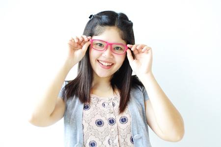 Portrait of beautiful Asian woman holding glasses