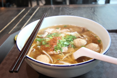 style noodle soup with vegetables on table