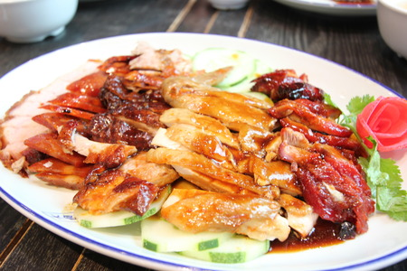BBQ duck over steamed rice Stock Photo