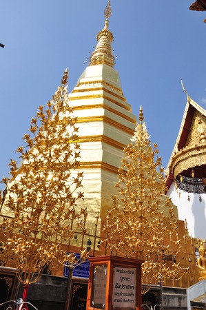 Golden Pagoda at Wat Phra That Cho Hae  the Royal Temple , Phrae Province, Thailand