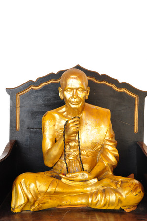 The gold buddha statue is on the white background