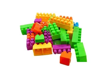 Toy colorful plastic blocks isolated on white  Stock Photo