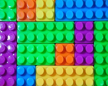 Toy colorful plastic blocks isolated on white background photo