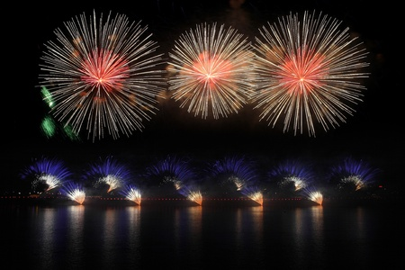 Pyrotechnic display shot from a barge with nice water reflection of the fireworks. Stock Photo - 9198990