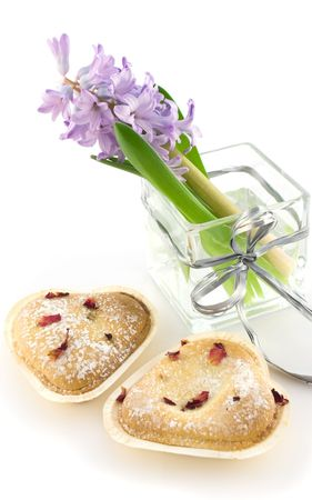 Hyacinthus in glass vase with cookies photo