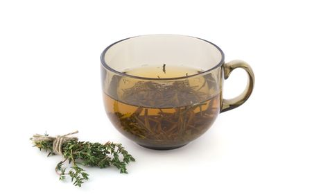gunpowder tea: Cup of green tea with a bundle of herbs Stock Photo