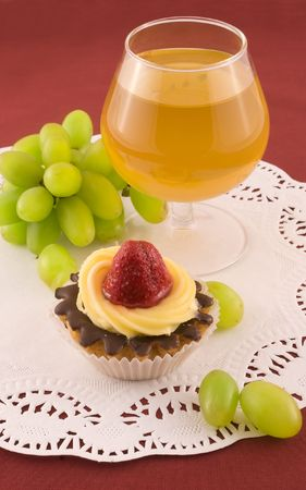 Fresh cake with strawberry, grapes and glass of white wine photo