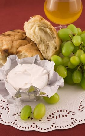Fresh  pita bread with grapes and cheese with white mold photo