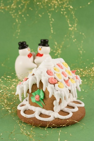 traditional christmas gingerbread house with snowmans photo