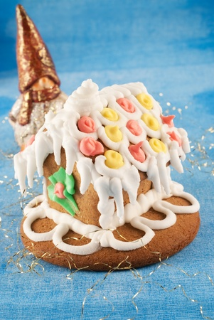 traditional christmas gingerbread house with gnome photo