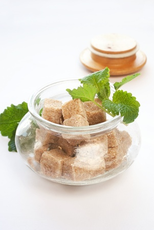 brown sugar in glass bowl with fresh herbs Stock Photo - 9232567