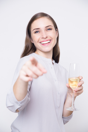 professional flute: Tipsy businesswoman with flute pointing at camera
