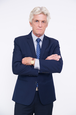 crossing arms: Serious senior man crossing arms on chest