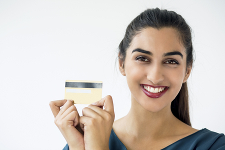 Smiling Latin-American woman holding credit card