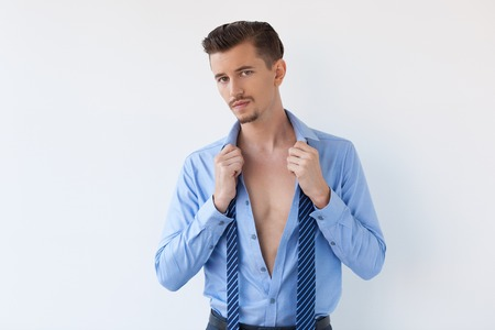 Thoughtful Young Handsome Business Man Undressing