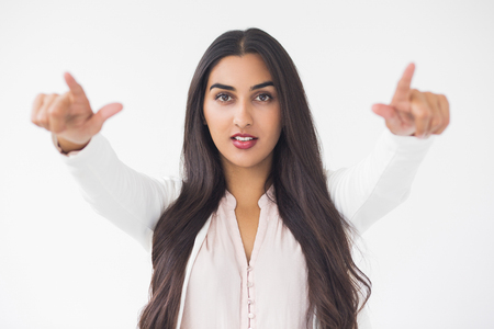 Content Gorgeous Indian Woman Pointing at Camera Stock Photo
