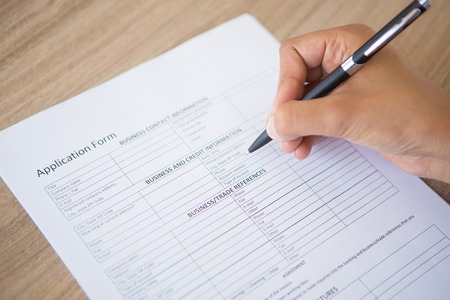 completing: Hand Completing Application Form
