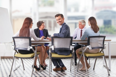 Smiling young businessman at meeting Stock Photo