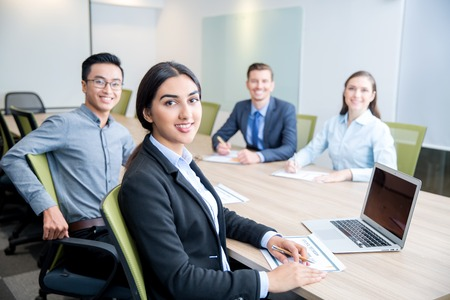 Smiling Business Lady Working with Colleagues