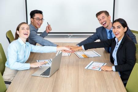 teamwork people: Joyful Business Team Joining Hands Together