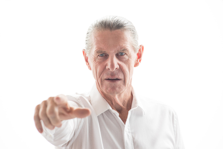 looking towards camera: Closeup of Serious Senior Man Pointing at You