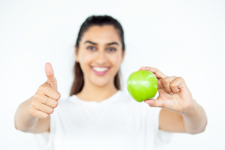 Closeup of Smiling Woman Recommending Apple Stock Photo