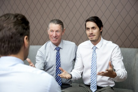 persuading: Two Business Men Offering Proposal to Partner