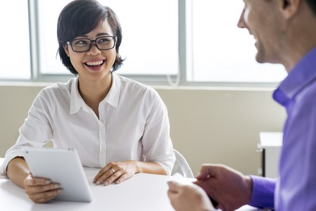 Happy hr manager having interview with candidate Stock Photo