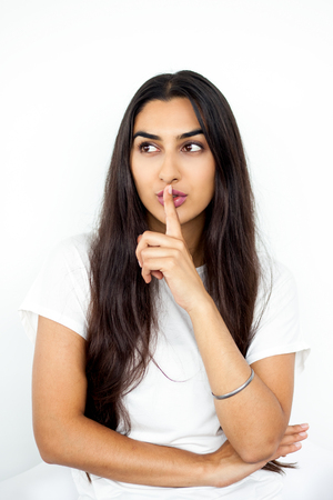 Beautiful young Indian woman having secret Stock Photo