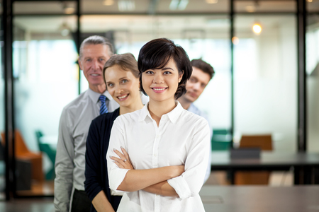 happy business team: Successful young Asian female leader and her team