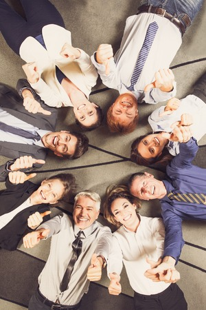 Cheerful Successful Business Team with Thumbs Up