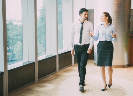 Business People Walking in Office 1