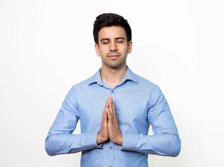 Serene man with closed eyes enjoying silence